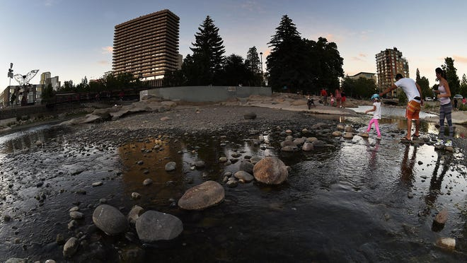 The Truckee River barely covers the rocks in its bed as it flows toward downtown Reno on June 17.