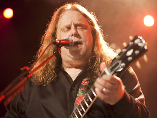 Warren Haynes performs on stage at the P.C. Richard