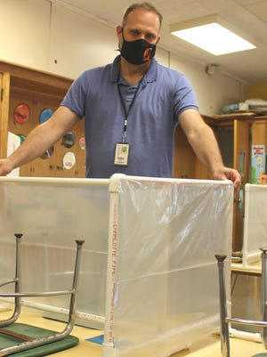 Marc Kramer, Quincy superintendent, gives credit to the maintenance staff and volunteers for building 350 PVC dividers for elementary classrooms. It's one of the 2020 back-to-school challenges.