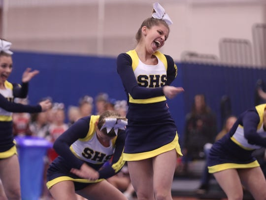 Catie Marks with Spencerport High School cheers with