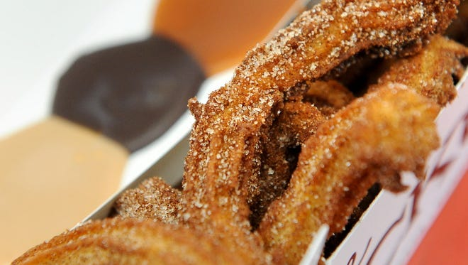 Churros at the Ruckus in Shorewood are served with a choice of dipping sauce, peanut butter (from left), spiced fudge and salted caramel.