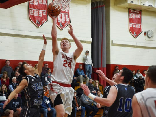 Red Hook High School's Dennis Hare takes a layup against Valley Central on Jan. 16.