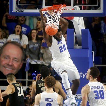 MTSU's Giddy Potts (20) dunks the ball during the game