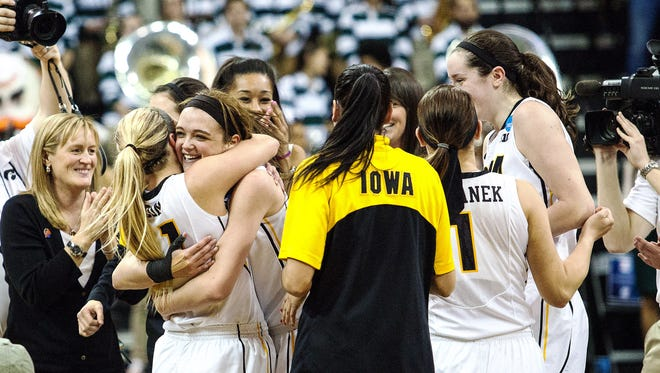 The Iowa Hawkeyes convene at center court to celebrate after the second half of play during the second round of the NCAA Women's Basketball Championship at Carver-Hawkeye Arena in Iowa City on Sunday, March 22, 2015. The Hawkeyes beat the Hurricanes 88-70 to advance to the Sweet 16.