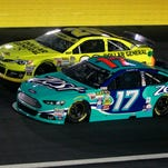 Matt Kenseth, left, and Rick Stenhouse Jr. during the Bank of American 500 on Saturday.