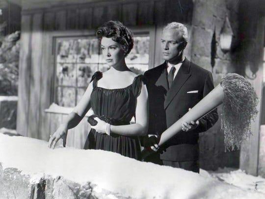 Barbara Rush and Marlon Brando, with the world's largest