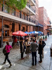 People gather in The Alley in Montgomery, Ala. on Thursday