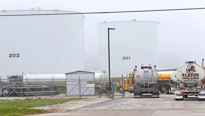 Fuel tankers wait in line Wednesday to fill up at the U.S. Oil facility on N. 107 St. in Milwaukee. With plenty of oil on the market and few disruptions, gas prices are likely to remain steady this summer, analysts say.