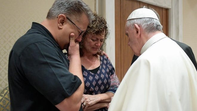Pope Francis meets Nick Solomon (left) and Jodi Solomon, the parents of Beau Solomon, a University of Wisconsin-Madison student whose body was found in Rome's Tiber river this week, during private encounter shortly before holding an audience with French pilgrims in a Vatican auditorium.