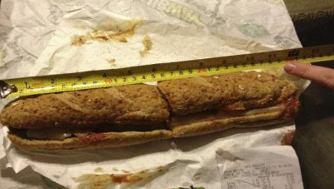 One of the plaintiffs in the case shows a sandwich measuring less than the advertised 12 inches, as included in the civil complaint.