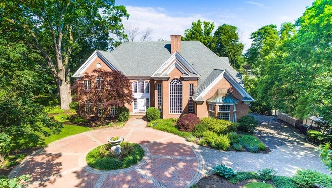 This 16-room home on 1.25 acres in Morris Township has five bedrooms, two of which could be master suites, as well as two designer kitchens and a garage for six cars.