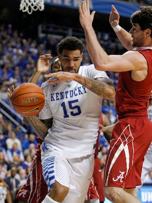 Kentucky's Willie Cauley-Stein drives past Alabama's Riley Norris in the first half of a game Jan. 31 at Rupp Arena in Lexington, Ky.