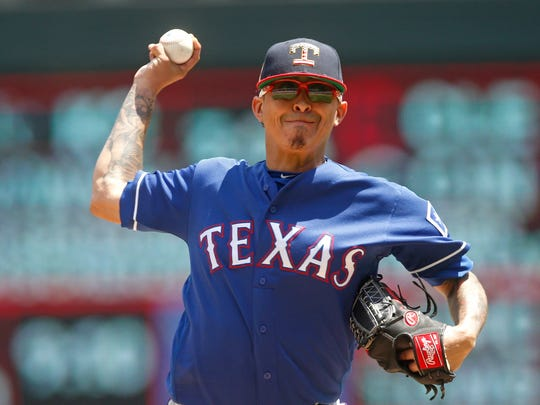 Texas Rangers pitcher Jesse Chavez throws against the Minnesota Twins in the first inning July 6 in Minneapolis.