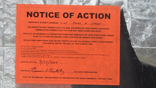 A notice of action is posted on the door of 1225 S. A St. in Richmond. After fighting with the home's owner for a large part of the year over the fate of the building, city officials are ready to tear it down.