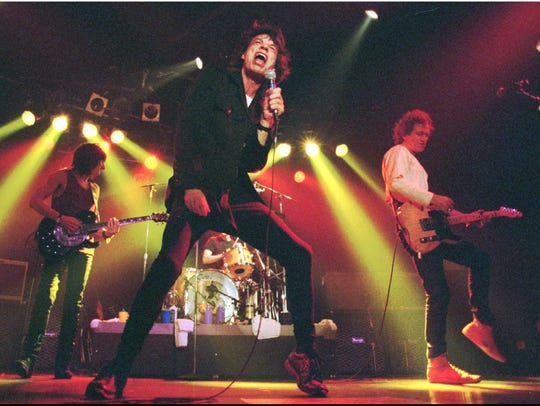 """Mick Jagger, Keith Richards, right, and Ron Wood, left, of the Rolling Stones, belt out a song during a preview concert for their """"Voodoo Lounge"""" tour at RPM night club in Toronto Tuesday night, July 19, 1994."""