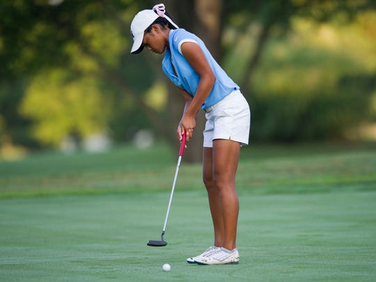 Lauren Guiao, 17, hopes to sink her putt during the SIAC girl's high school tournament at McDonald Golf Course on Saturday morning.