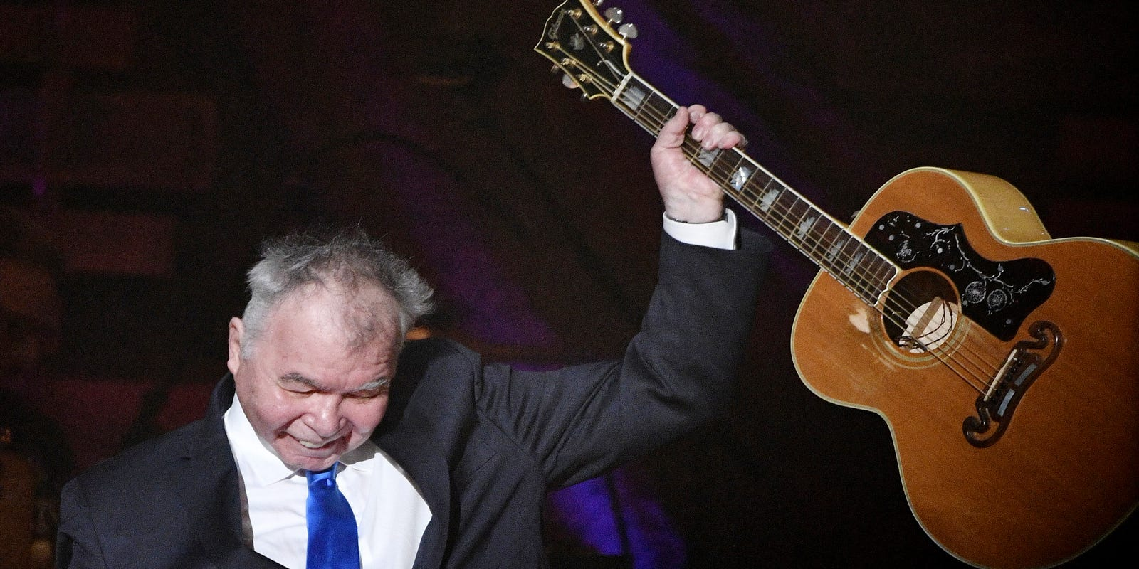 Play John Prine's music. Play it as loud as possible.