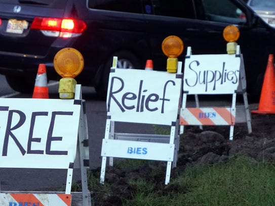 Signs alert evacuees to a community-created evacuation