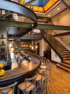 A sweeping stair defines the bar area at Winston, at 130 E Main Street in Mount Kisco.