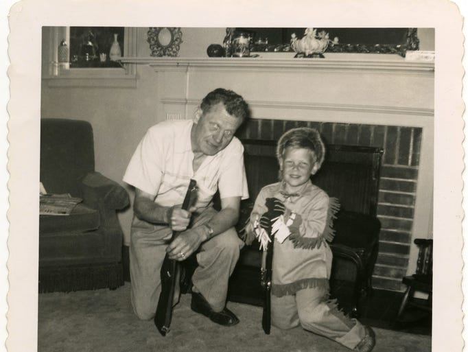 """John Olbrantz, director of the Hallie Ford Museum of Art, is about 6 in this photo taken with his father, Walter """"Bud"""" Olbrantz, proudly wearing his """"official"""" Davy Crockett outfit. His dad died in 1961, when he was 11."""