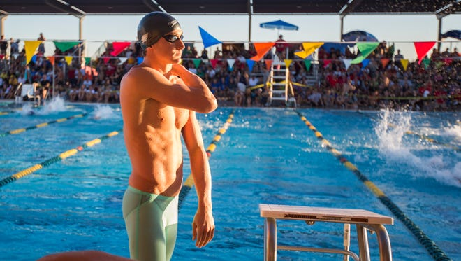 Chaparral's Ryan Hoffer waits for his final race during the State Tournament at the Skyline Aquatic Center in Mesa, AZ on Saturday, Nov. 8, 2014.