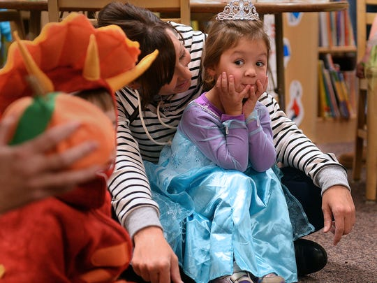 Ellison Garza, 3, sits with Schlene Mahoney of Small