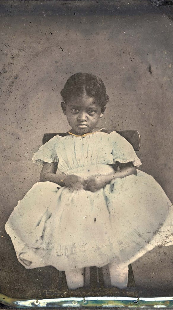 An unidentified African-American girl, possibly a slave,