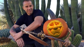 Ray Villafane in the Carefree Desert Gardens with one of his creations.