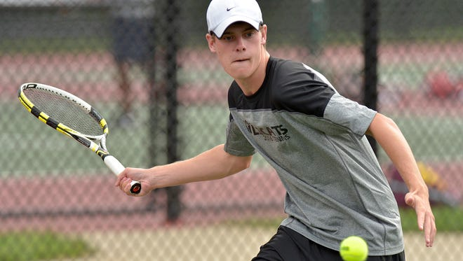 Getting set to return the ball Thursday afternoon is Matt Decker, who is Plymouth's No. 1 singles player.