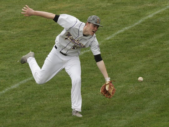 Lexington's Josh Aiello attempts to catch a foul ball during a home game against Clear Fork on Saturday.