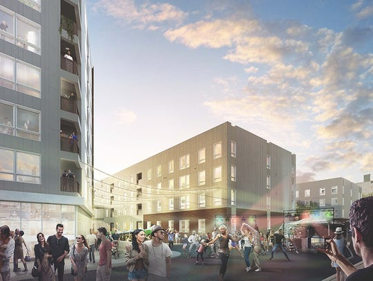An artistic rendering of The Residences at Mid-town Park located on W. Ninth Street between Shipley and Orange streets. A five-level underground garage, Mid-town Park Garage,  is located below and will open April 2 with 511 parking spaces.