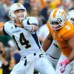 Tennessee's Derek Barnett (9) rushes in for a sack against Chattanooga last season . Barnett was a 2014 second-team all-Southeastern Conference selection after posting 10 sacks.
