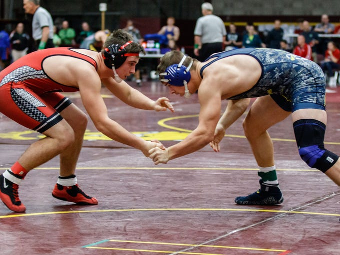 Germantown wrestler Trey Wilson (right) grapples with