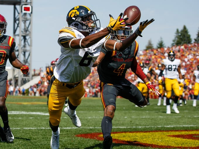 Iowa's Ihmir Smith-Marsette (6) catches a pass in the