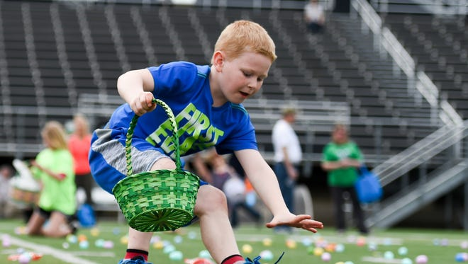 Kids race to find Easter eggs on Saturday, April 8, 2017, during the Special Egg Event at Valley Stadium hosted by Journey Church.