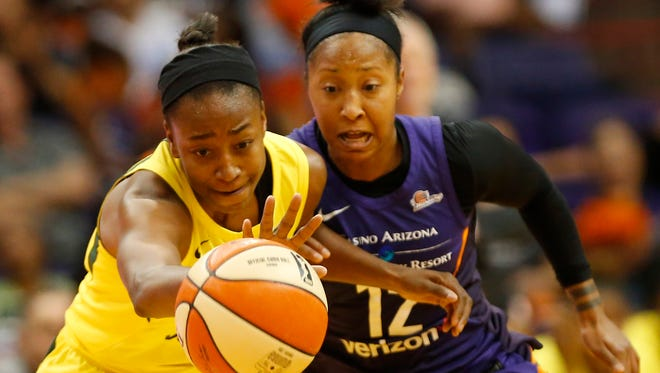 Seattle Storm guard Jewell Loyd (24) and Phoenix Mercury guard Briann January (12) chase down a loose ball during Game 4 of WNBA semifinals at Talking Stick Resort Arena September 2. 2018.