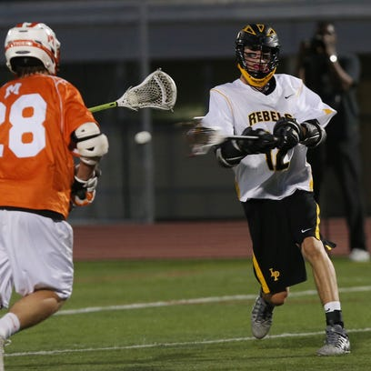 Lakeland/Panas'  Drew Thompson (12) fires a shot in