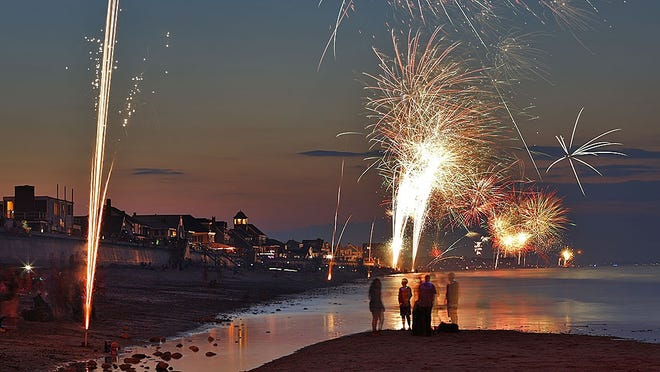 The sky explodes in color at Marshfields Sunrise Beach with fireworks just after dark on Wednesday July 3, 2019  Greg Derr/The Patriot Ledger