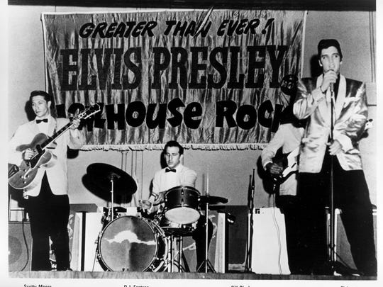 A early publicity photo shows Elvis Presley with Scotty Moore, D.J. Fontana and Bill Black.