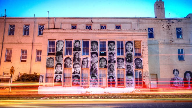 """Similarly to this projection in Santa Fe, N.M., images of Nashvillians will be installed inside OZ Arts as part of JR's global portrait project, """"Inside Out."""""""