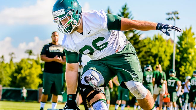 MSU defensive tackle, Mike Panasiuk, runs through an agility drill during the first practice of MSU football fall camp Saturday August 6, 2016 at the Duffy Daugherty practice facility in East Lansing.  KEVIN W. FOWLER PHOTO