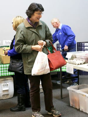 Manitowoc County resident Shirley Pozorski peruses the offerings at the inaugural Manitowoc Winter Market in November 2016.