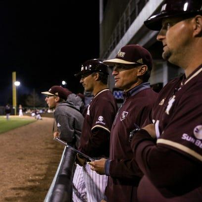ULM baseball coach Michael Federico (center) led the