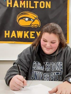 Hamilton golfer Cora Sharp signed with Cornerstone University.