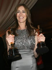 Kathryn Bigelow holds her best picture and best director