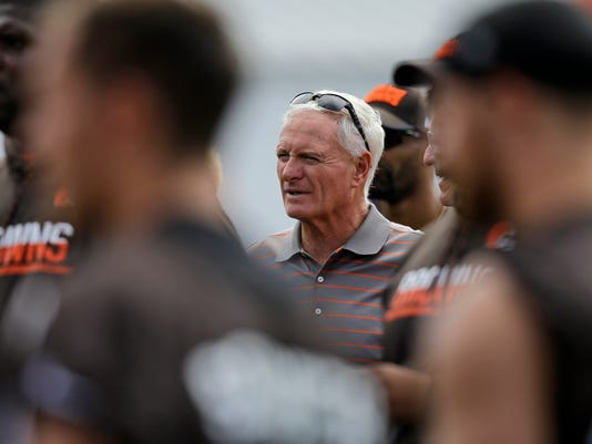 This July 28, 2017 photo shows Cleveland Browns owner Jimmy Haslam watching during practice at the NFL football team's training camp facility in Berea, Ohio. Haslam says he's embarrassed the franchise hasn't been more successful under his leadership. Haslam and his wife, Dee, have owned the club since roughly midway through the 2012 and the Browns have gone a combined 15-49 over the past four seasons. Despite the rough season, Haslam, who spoke Saturday, July 29, 2017 before the Browns had their first training camp practice in pads, is convinced coach Hue Jackson is the right choice to turn the team around. (AP Photo/Tony Dejak)