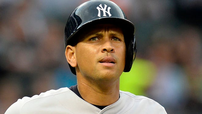 Aug 6, 2013; Chicago, IL, USA; New York Yankees third baseman Alex Rodriguez (13) gets walked by Chicago White Sox starting pitcher Chris Sale (not pictured) during the first inning at U.S. Cellular Field. Mandatory Credit: Mike DiNovo-USA TODAY Sports