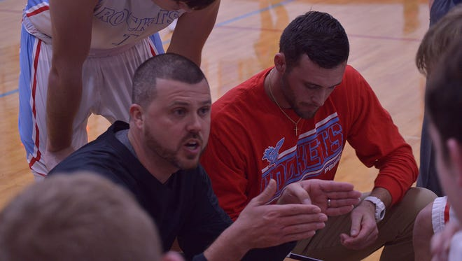 Ridgedale's Nathon Loney, red shirt, is in his first season as a boys basketball head coach.
