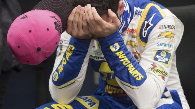 Chase Elliott (9) gathers himself after winning a NASCAR Cup Series playoff race on Sunday at Martinsville Speedway.