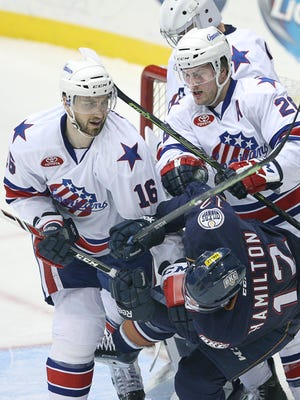 In the last-ever appearance in Rochester for the Oklahoma City Barons, Matt Pelech (16) and Johan Larsson tell (show?) Ryan Hamilton that he's not welcome in Matt Hackett's goal crease. Edmonton is moving its AHL team to Bakersfield, Calif., for next season.